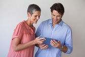 Business team looking at tablet pc — Stock Photo