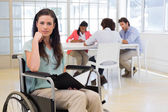 Attractive disabled businesswoman at work — Stock Photo
