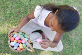 Girl counting easter eggs — Stock Photo