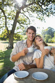 Couple having tea outside in a cafe — Stock Photo