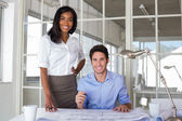 Architects working on building plans — Stock Photo
