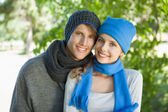 Cute couple in hats and scarves — Stock Photo