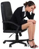 Worried businesswoman on swivel chair — Stock Photo