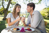 Couple outside toasting with champagne — Stock Photo