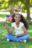 Girl celebrating independence day in the park — Stock Photo