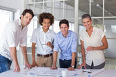 Team of architects smiling at camera — Stock Photo