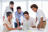 Business people looking at laptop — Stock Photo