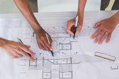 Team of architects going over blueprints — Stock Photo