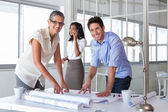 Attractive architects going over plans — Stock Photo