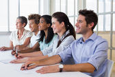 Business people attentive at presentation — Stock Photo