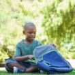 Schoolboy opening his schoolbag — Stock Photo #46791821