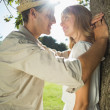 Couple leaning against tree — Stock Photo