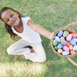 Girl showing basket of easter eggs — Stock Photo #46793407