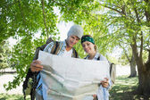 Couple on a hike consulting the map — Stock Photo