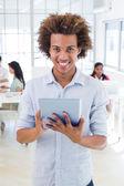 Businessman using tablet pc — Stock Photo