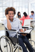 Businessman in wheelchair holding planner — Foto Stock
