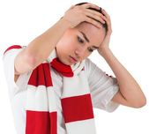 Disappointed football fan looking down — Stock Photo
