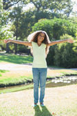 Girl outstretched in the park — Stock Photo