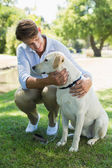 Man with his labrador in the park — Stock Photo