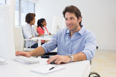 Businessman with disability works hard — Stock Photo