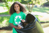 Environmental activist picking up trash — Stock Photo