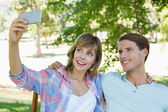 Couple on bench in the park — Stock Photo