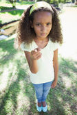 Girl frowning in the park — Stock Photo