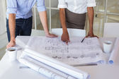 Two architects looking at blueprints — Stock Photo