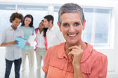 Businesswoman with coworkers working — Stock Photo