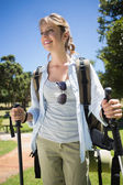 Fit smiling woman going for a hike — Stock Photo