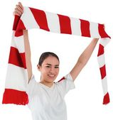 Fan waving red and white scarf — Stock Photo