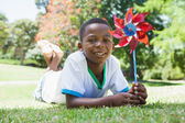 Little boy holding pinwheel in the park — Stock Photo