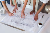 Architects looking at building plans — Stock Photo