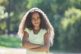 Girl frowning at camera in the park — Stock Photo