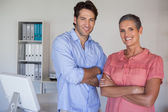 Business team smiling at camera — Stock Photo