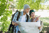 Couple on a hike consulting the map — Foto Stock