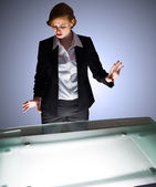 Businesswoman gesturing by a desk — Stock Photo