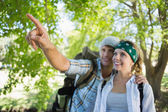 Couple on a hike with man pointing — Stock Photo