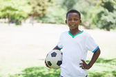 Little boy holding football in the park — Foto Stock