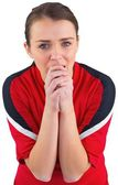 Nervous football fan in red — Stock Photo