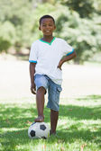 Boy with football in the park — Stock Photo