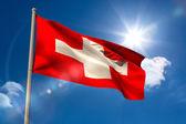 Swiss national flag on flagpole  — Stock Photo