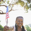 Girl waving american flag — Stock Photo #48234737