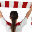 Football fan waving scarf — Stock Photo