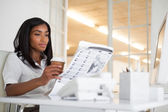 Businesswoman reading newspaper — Stock Photo