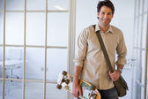 Businessman with his skateboard — Stock Photo