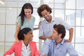 Coworkers congratulating each other — Stock Photo