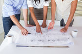 Architects working on blueprints — Stock Photo