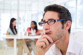 Businessman with glasses concentrating — Stock Photo