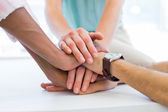 Colleagues bringing hands together — Stock Photo
